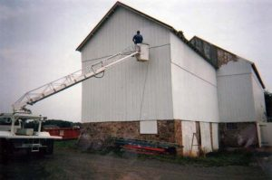 Bob painting in ladder truck.