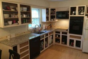 Kitchen cabinets during refinishing process.